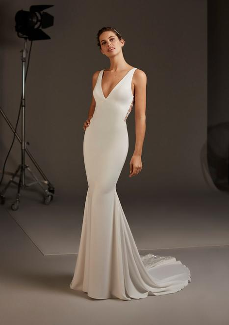 Aquila Wedding                                          dress by Pronovias