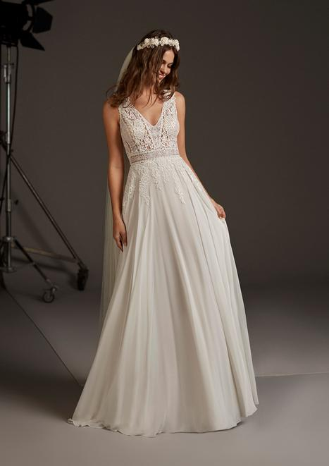Comet Wedding                                          dress by Pronovias