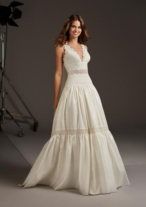 Draco Wedding                                          dress by Pronovias