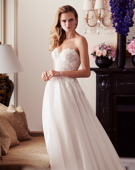 Paislee Wedding                                          dress by Caroline Castigliano