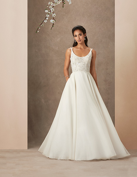 Chrissy Wedding                                          dress by Caroline Castigliano