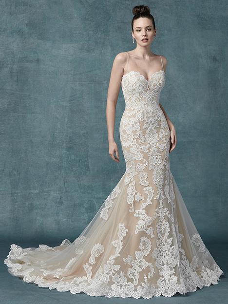 Janson Wedding                                          dress by Maggie Sottero
